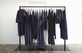 Navy and black clothing rack inside.