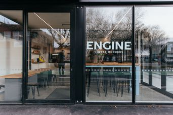 The exterior of the cafe and window signage.