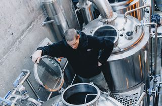 A man brewing beer at Eruption Brewing Lyttelton.