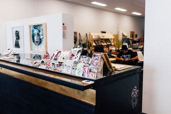 Shop interior showcasing urban art.