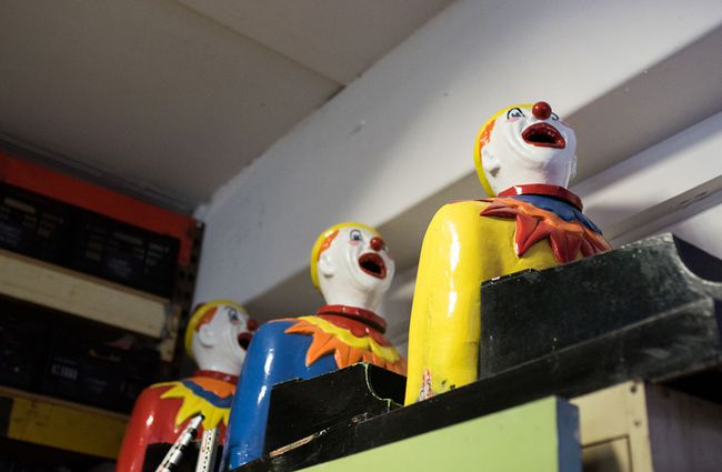 Colourful clowns with their mouths open.