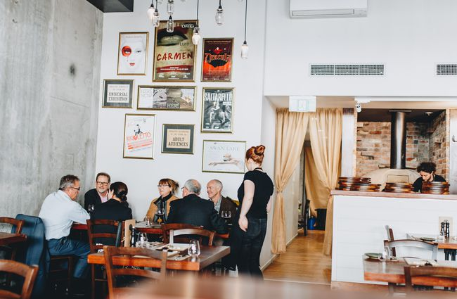 A group of dining at a table inside Francesca's Italian Kitchen, Christchurch.