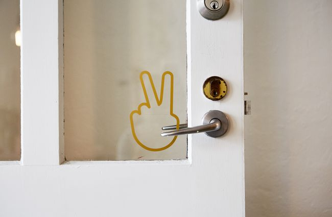 A peace sign on a door of Frank's Newtown cafe in Newtown Wellington.