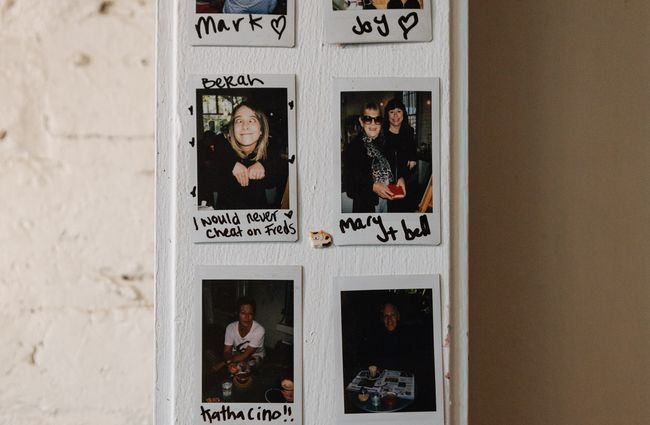 Poloroids on wall.