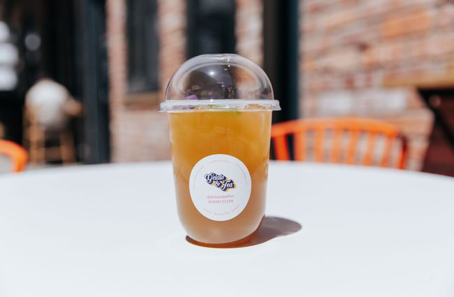 A take away cup of iced tea.