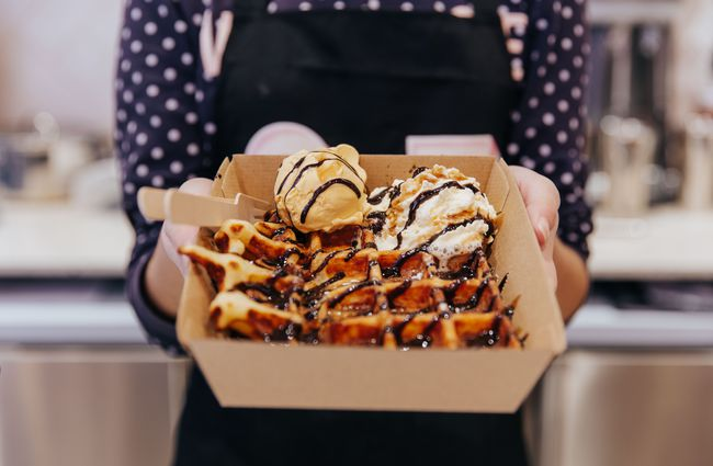 Waffle with scoop of gelato on top.