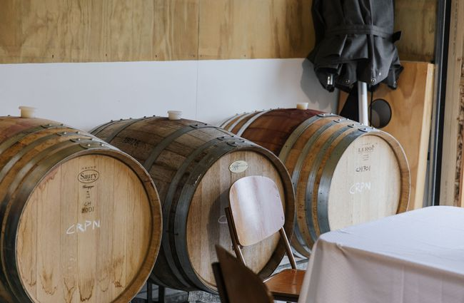 Close up of wine barrels.