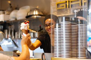 A woman serving a gelato.