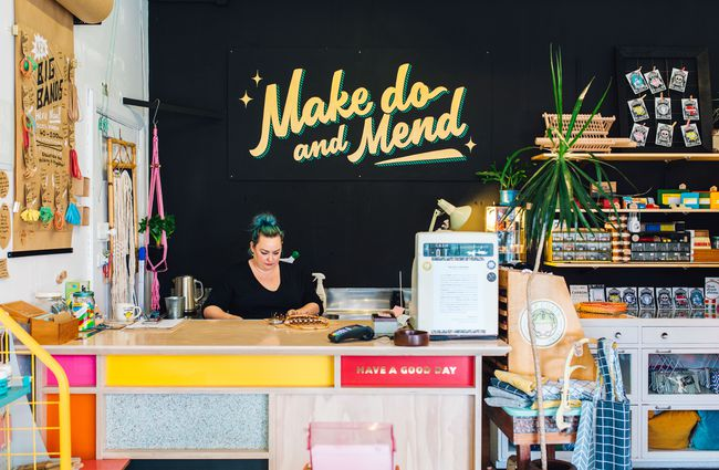 A woman working behind the counter at Good Housekeeping Wellington shop, New Zealand.