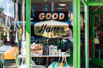 The entrance to the shop and window signage outside Good Housekeeping Wellington shop, New Zealand.