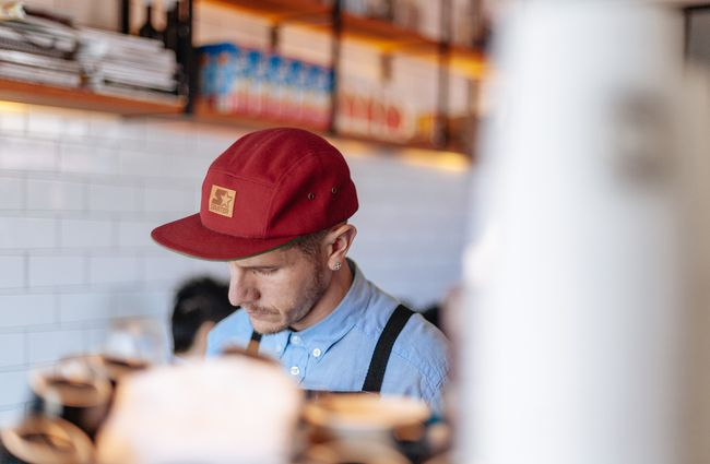 A man working behind the counter.