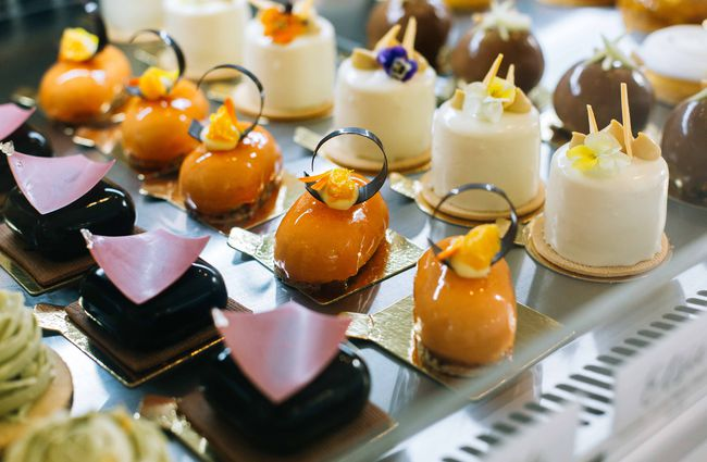 Row of little fancy cakes.