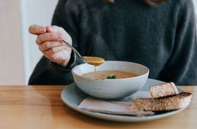Woman eating soup.