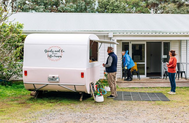 Customers queuing at Greedy and Co caravan.