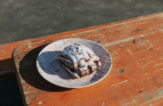 Pastry with icing sugar on a table.