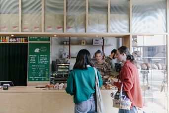 Customers at the counter at Grizzly Baked Goods at The Welder.