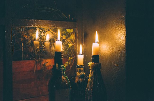 Candles in wine bottles.