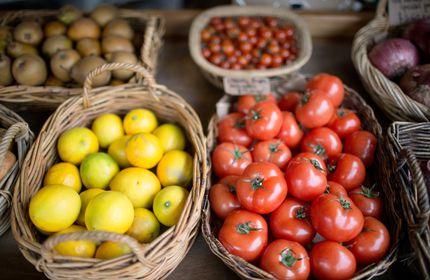 Close up of tomatoes and lemons.