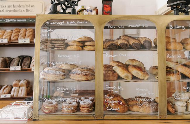 Pastries in a cabinet.
