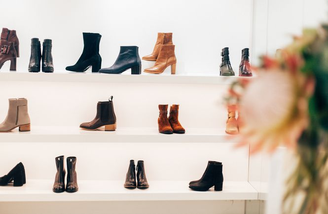 Boots on display on shelves.
