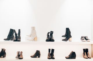Boots on a shelf.