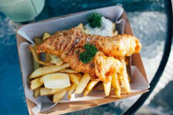 Fish and chips on a table.