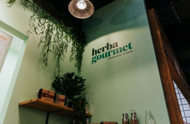 A painted Herba Gourmet sign.