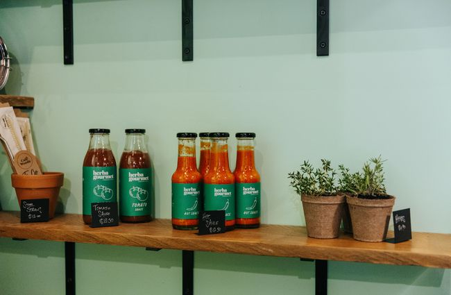 Sauces on display on a shelf.