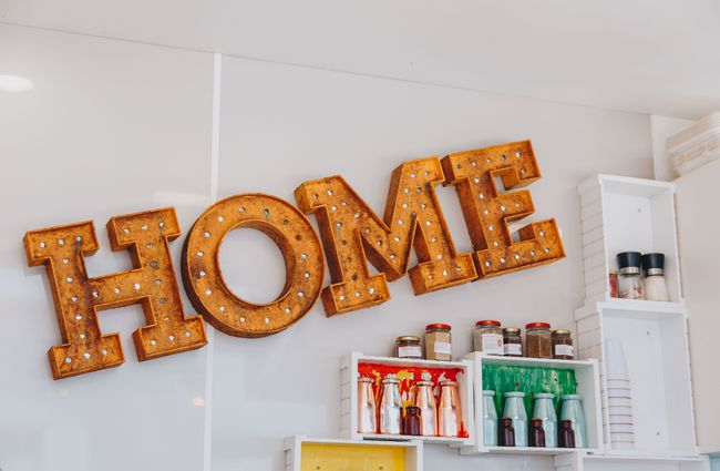 A 'Home' sign inside the container.