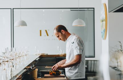 Th chef Simon Levy working in the kitchen inside Inati restaurant Christchurch, New Zealand.