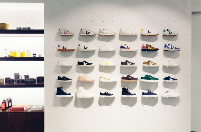 Veja shoes and other branded shoes on display.