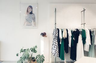 Womenswear on display inside the store.