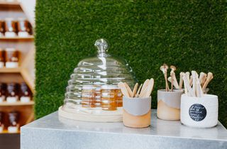 Hive shaped glass dome and honey display.