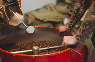 Red coffee roasting machine.