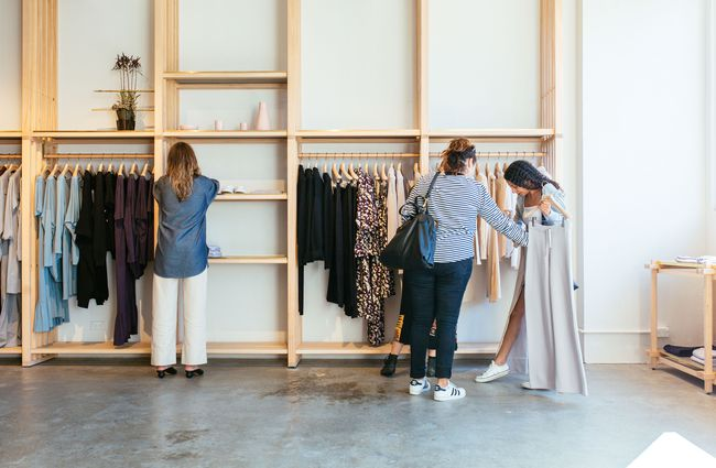 Two women looking at clothes inside Kowtow Wellington clothing store, New Zealand.