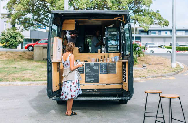 Woman ordering from a coffee truck.