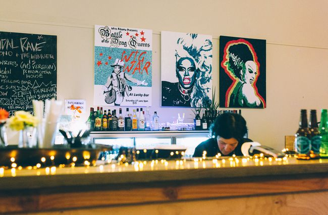 Posters and fairy lights by front counter.