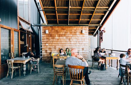 Customers hanging out on the deck at Lyttelton Coffee Company cafe.