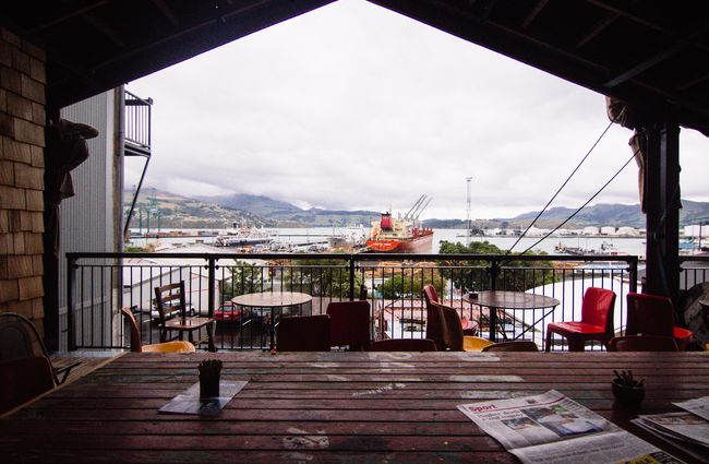 A photo of the harbour taken from the outdoor deck at at Lyttelton Coffee Company cafe.