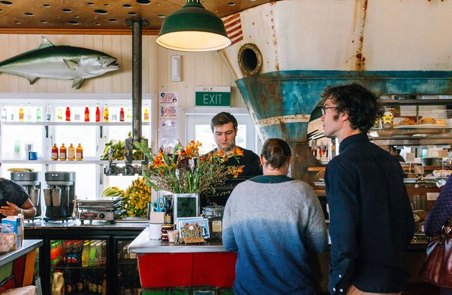 People being served at the counter of Maranui cafe Wellington.