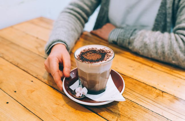 Photo of a hot chocolate on a wooden table.