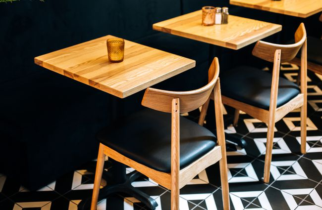 Wood and black chairs and tables at a Wellington restaurant.