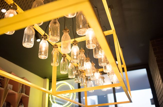 Milk bottles lights hanging from the roof.