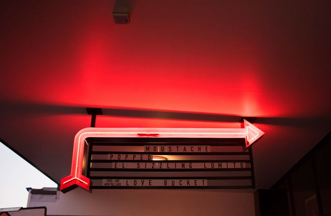 Red neon arrow.