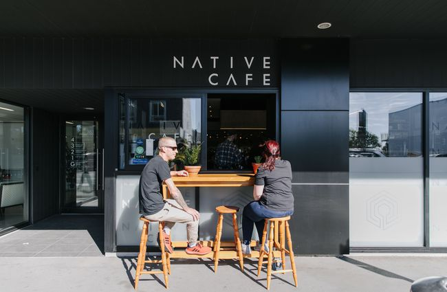 Customers sat on stools outside Native cafe.