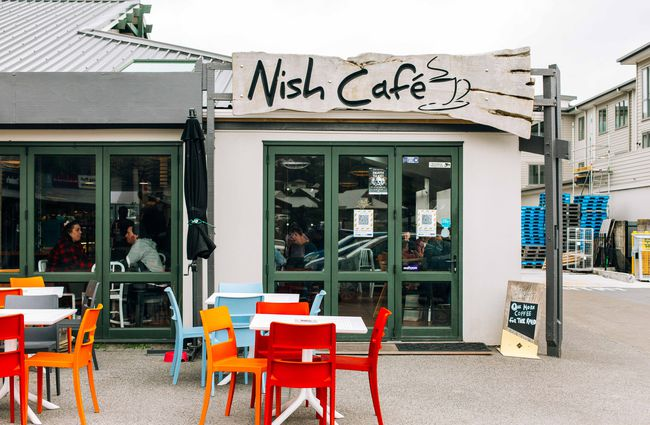 Exterior view of Nish Cafe with tables outside.