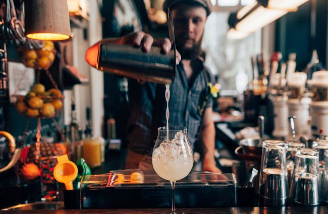 A man pouring a cocktail.