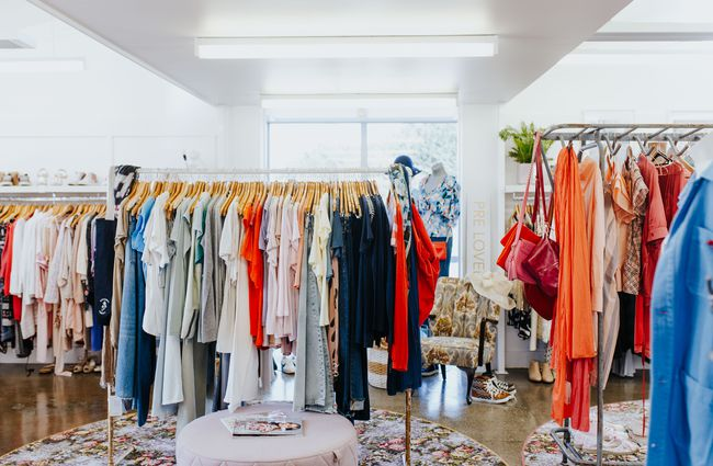 Racks of colourful clothing.
