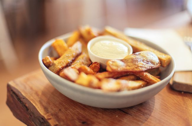 Golden fries in a bowl.