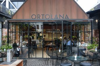 Exterior front sign of Ortolana.